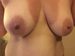 Day after getting back from girls weekend in the sun tanlines.  I can't take enough pics of her hot tits