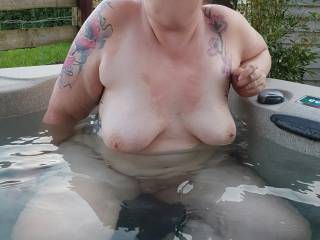 Chilling in the hot tub at the back of the cabin