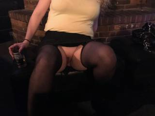 I asked Kiki to meet me at the bar for a beer and she showed up in this outfit. Then I looked over and saw that she had hiked up her skirt to show me that she wasn't wearing any panties. Any ladies want to meet us for a cold one and a shot?