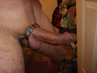 A heavy chunk of metal weighing down my big dick.  Mouth watering isn't it.