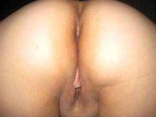 A naked ass and your pussy showing too....ya have MY cock's attention!