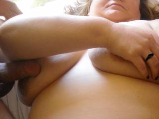 Mmmm! Can I take her place, with your cocks on my titties, and maybe licking her sweet pussy if she wants? Love it!!