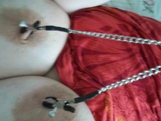I wanna pull that chain all the way over to me so I can slide my cock between those great tits!