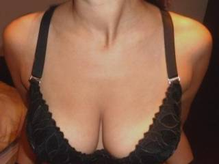 VERY sexy picture!  Awesome cleavage, wanting to lick those gorgeous breasts of yours!  one for each of us?  you like that idea? :)  we sure do!