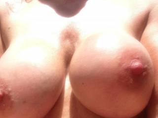 Let me use my hard cock to rub sun lotion all over your beautiful tits so that they are nice and slippery, then I'll slip my lotion cover cock between them and fuck them until I coat them with my own special lotion.