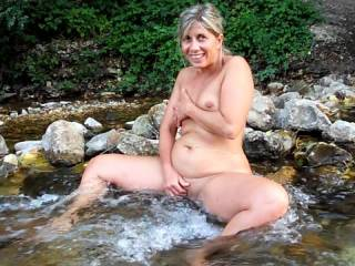 Lisa naked fondles her pussy in a waterfall