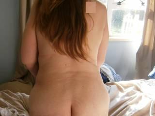 Mmmm defo bent over nice ass!!!!