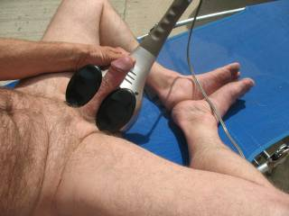 Enjoying my back massager on my cock outside on the patio last summer. Love being naked & free outside in the summer. Are you waiting for summer too?