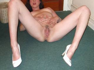 damn sexy with this inviting spread and the half-innocent-half-CFM white pumps! loved to start with eating her yummy pussy, and then some... :-)