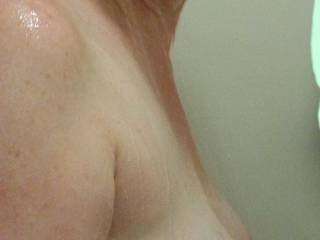 Heavy milk filled lactating breasts hanging free in the shower!