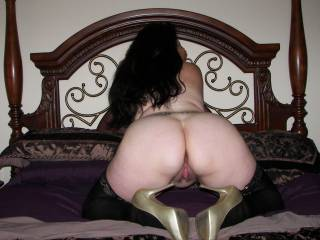 Showing her ass in nylons and heels