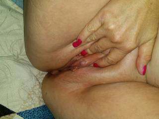 Holding her juicy cunt open so you can come lap and suck on her swollen clit.....