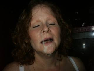 Here she is with a huge cum shot dripping from her face.  She loved this load.