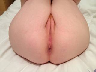 Pulling my knees up so you can see my naughty bits. I'm a redhead - do you like my pussy? Anything else you like? ;o)