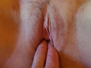 I uploaded 3 pics...me fingering her, me holding her lips open and wife holding her lips open. Which is better?