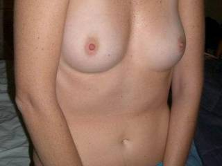 My wife's tits. Feel free to cum on them.