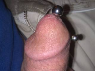 """Another view of the large (3/8"""") bead I added to the curved barbell in my PA piercing. The weight makes the barbell slide back and forth inside my cock.  Amazing!!"""