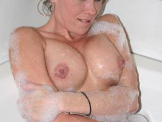 pretty woman with lovely tits, attractive areola round those nipples I'd love to suck, if I was there she would experience explosive orgasms to make her quiver with ecstacy