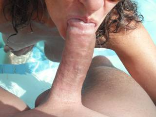 Sucking my Hubby's lovely smooth thick cut cock in the swimming pool at home.