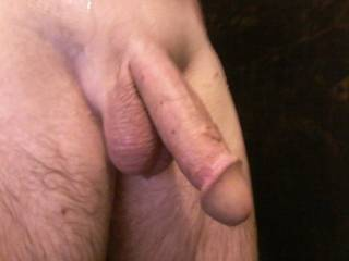 Freshly shaved and wet in a warm shower waiting for someone