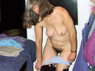 Julie reluctantly strips nude on camera for the first time