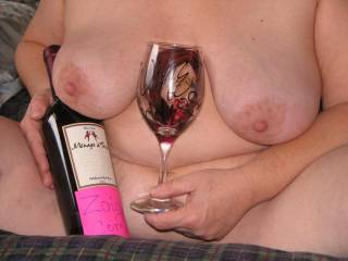 Don't know if I would get any of the wine into the glass.  Rather pour it over those great tits.
