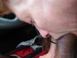 More pics of me with Cyndi the office Slut. Here she is Sucking my Black Cock in the Company Parking lot during our lunch break. Her asshole racist husband was in the building about 10yards from us and didn\'t have a clue his beloved white wife was in my c