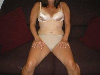 That's a fine MILF to be wearing granny panties. I'd have something sexier to adorn her about to be exploited body
