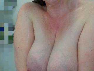 She just loves the camera, and the camera loves her huge milk filled lactating tits!