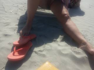 Flashing her pussy at the beach again. Looking for her next partner. Anybody want to help