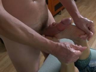 He directs my feet as I wrap my toes around his throbbing cock. I can tell he\'s getting close to cumming from his breaths and moaning~!  Would you like to cum like this also??