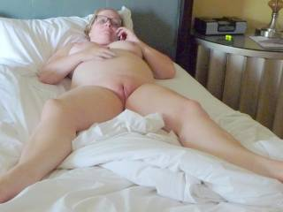 chubby wife posing naked in hotel showing her big belly, pussy, and tits