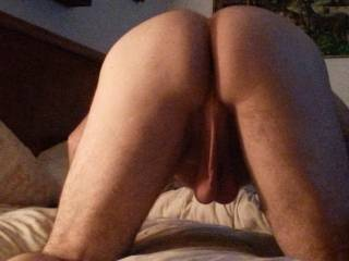 I want to suck and lick all of that... from your hairy thighs to those hot low hanging big balls... right up to those furry cheeks.  Then I would put a hand on each cheek and spread them open so I could tongue fuck your hole good