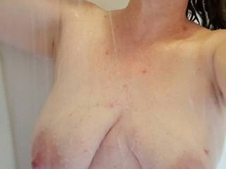 Heavy milk filled tits getting clean