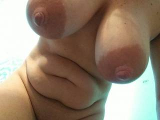 Natural tits, curvy body, bent over so you can see the girls hang and seem extra large.