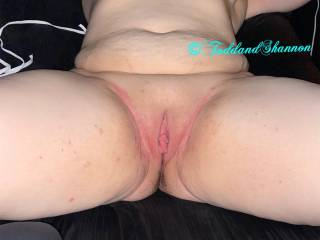 Shannon spread with a shaved pussy