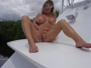 Oh the fun we'd have on that boat. I'd enjoy fucking you and watching you get fucked all over that boat ;-)