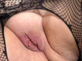 close up of her shaved puffy pussy