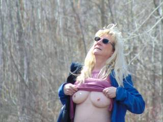 Flashing my boobs in a park while looking at a small plane flying by