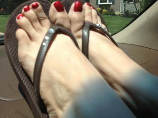 Stunning...just look at those shiny red seductive sexy toes! Wow!!