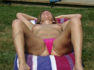 You don't mind if she has the bottom half of her bikini on. Do you?