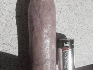 Another shot to compare my shaft to a cuckold's. D battery for comparison.