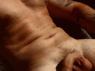 Took a shot of my relaxed husband laying in the sun moments before I started slowly sucking the cum right out of his much harder and larger dick 🍆💦🤤  I love his cock 😍 so much I would like to share it with a sexy lady who might also be into me