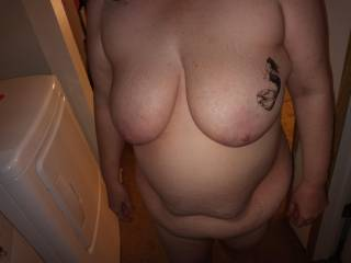 Naked wife doing laundry