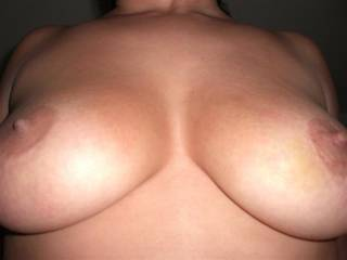 Nice big round tits and so firm. The nipples are sexy too. Would love to hold them in my hands.