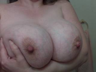 We can hold them for you, but i will let my wife kiss and suck them  as i go down you and you stroke me to CLIMAX all over those great breasts!!