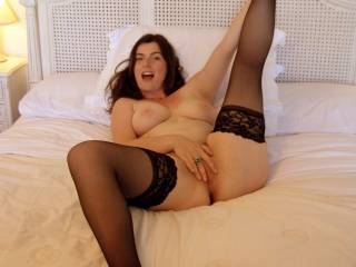 Mmmm, big tits, stockings and fingers ready to play with pussy. It's a great pic and a great way to spend the afternoon!