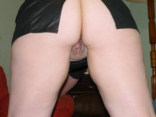 Showing off her pussie in a short skirt from behind