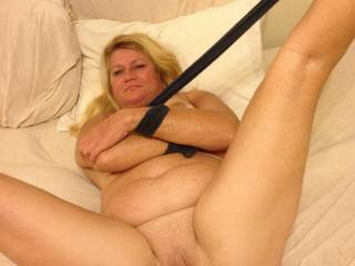 Hands tied and legs spread wide