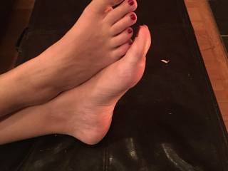 The wife's sexy feet up on a stool. She wants to see if anyone likes her feet.